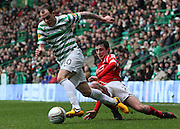 16.03.2013 Glasgow, Scotland. Anthony Stokes is tripped by Joseph Shaughnessy during the Clydesdale Bank Premier League match between, Celtic and Aberdeen, from Celtic Park Stadium.