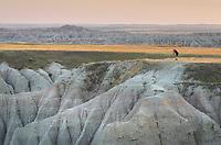 Photographer at White River Valley Overlook. Badlands National Park South Dakota