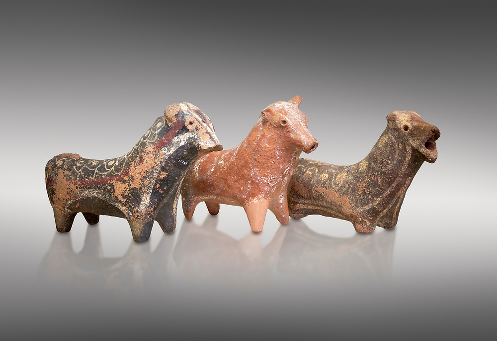 Minoan decorated bull shaped rhython (rhytha) for ritual liquid offerings, Phaistos 1800-1650 BC; Heraklion Archaeological  Museum, grey background. .<br /> <br /> If you prefer to buy from our ALAMY PHOTO LIBRARY  Collection visit : https://www.alamy.com/portfolio/paul-williams-funkystock/minoan-art-artefacts.html . Type -   Heraklion   - into the LOWER SEARCH WITHIN GALLERY box. Refine search by adding background colour, place, museum etc<br /> <br /> Visit our MINOAN ART PHOTO COLLECTIONS for more photos to download  as wall art prints https://funkystock.photoshelter.com/gallery-collection/Ancient-Minoans-Art-Artefacts-Antiquities-Historic-Places-Pictures-Images-of/C0000ricT2SU_M9w