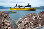 Levante ferry coming into port at Piso Aetos, Ithaca, Greece. Ithaca, Ithaki or Ithaka is a Greek island located in the Ionian Sea to the west of continental Greece. Ithacas main island has an area of 96 square kilometres. It is the second-smallest of seven main Ionian Islands.