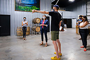 "22 JULY 2020 - AMES, IOWA: THERESA GREENFIELD (center) and ELLIOT THOMPSON, owner of Alluvial Brewing, talk about the needs of small businesses during a visit by Greenfield to Alluvial Brewing in Ames, IA. Greenfield, a Democrat, is running for the US Senate against incumbent Republican Senator Joni Ernst. Recent polls have Greenfield slightly ahead of or statistically tied with Ernst, who is closely allied with President Donald Trump. Although Greenfield is not doing much in person campaigning with big events, she is meeting with business people across the state of Iowa to promote her ""Small Towns, Bigger Paychecks"" economic program.       PHOTO BY JACK KURTZ"