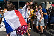 French nationals take selfie ahead of the match between France and Croatia in the World Cup Final, on the outside of a café. Paris, France.