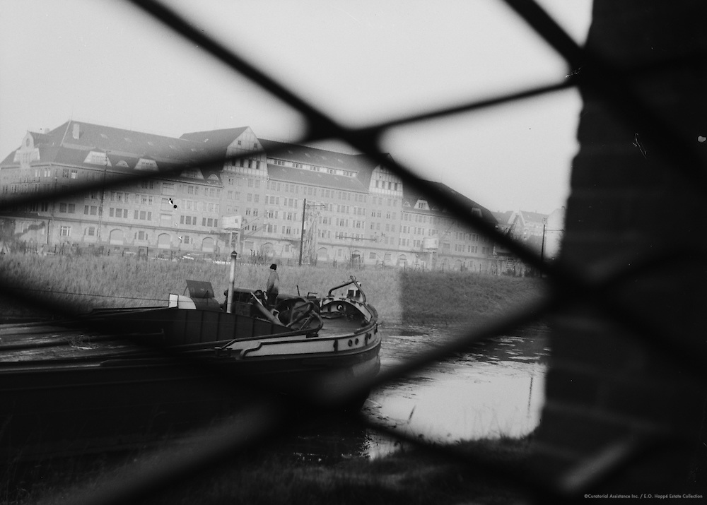 Barge in Canal Seen Through Chain Link Fence, Berlin, circa 1931