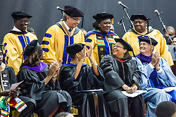 Members of the Class of 1965, the first class of the College of the Virgin Islands are recognized with special honors.  Fifty-first annual University of the Virgin Islands  Commencement Exercises.  UVI Sports & Fitness Center.  St. Thomas, VI.  14 May 2015.  © Aisha-Zakiya Boyd