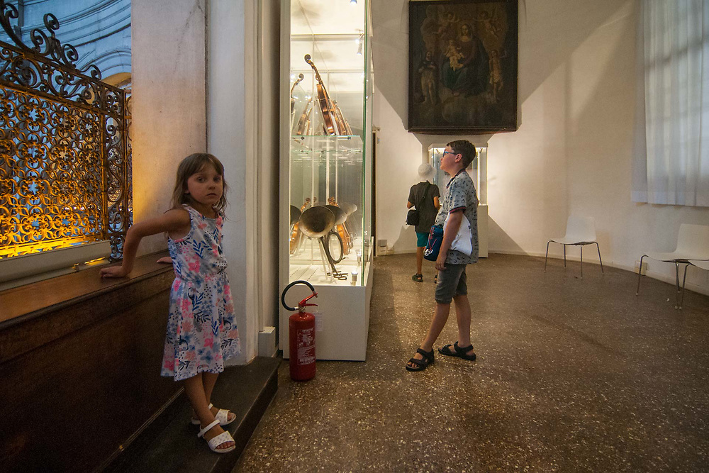 Tourists visit the museum ViVe, Vivaldi Venice, at Chiesa della Pietà on July 12, 2017 in Venice, Italy.  Chiesa della Pietà has just opened to the public the restored fresco of Tiepolo with the original colors and a museum with original documents of the institution clled La Pietà that in the past hosted abandoned children, and also with original musical instruments used by Vivaldi to teach to the children. ©Simone Padovani