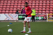 Keshi Anderson (30) of Swindon Town warming up during the EFL Sky Bet League 2 match between Swindon Town and Oldham Athletic at the County Ground, Swindon, England on 14 December 2019.