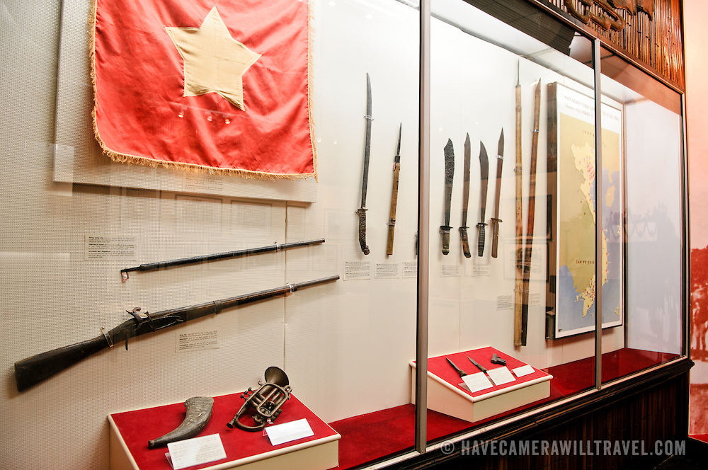An exhibit case with weapons used in the revolutionary struggle. The Museum of the Vietnamese Revolution in the Tong Dan area of Hanoi, not far from Hoan Kiem Lake, was established in 1959 and is devoted to the history of the socialist revolutionary movement in Vietnam.