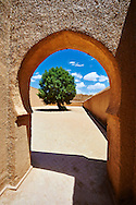 Arabesque adobe arch to the inner courtyard of the  Alaouite Ksar Fida built by Moulay Ismaïl the second ruler of the Moroccan Alaouite dynasty ( reigned 1672–1727 ). Residence of the Khalifa or Caid of Tafilalet until 1965. Tafilalet Oasis, near Rissini, Morocco .<br /> <br /> Visit our MOROCCO HISTORIC PLAXES PHOTO COLLECTIONS for more   photos  to download or buy as prints https://funkystock.photoshelter.com/gallery-collection/Morocco-Pictures-Photos-and-Images/C0000ds6t1_cvhPo<br /> .<br /> <br /> Visit our ISLAMIC HISTORICAL PLACES PHOTO COLLECTIONS for more photos to download or buy as wall art prints https://funkystock.photoshelter.com/gallery-collection/Islam-Islamic-Historic-Places-Architecture-Pictures-Images-of/C0000n7SGOHt9XWI