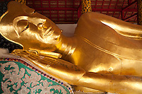 Reclining Buddha at Wat Pongsanuk - a sacred temple in Lampang. It is said that this temple was erected in 1888 by Kru Ba Anochidhamma Jindamuni. The temple architecture is mixed with a Burmese temple floor plan consisting of a three tiered roof in the centre and phayathat - small upwards of three tier roofs in the same size decorated on the centre, Viharn Phra Chao Pun Ong, Pongsanuk Temple is the unique jewel of Mahayan Buddhism Architecture of Lanna Kingdom.  Following its restoration Wat Ponsanuk received a merit award from UNESCO for its efforts in restoration.