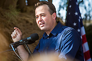 27 AUGUST 2012 - GILBERT, AZ:  KIRK ADAMS, a former speaker of the Arizona House of Representatives, speaks at a campaign event Monday. Sarah Palin campaigned for Arizona Republicans aligned with the Tea Party movement at a barbecue in Gilbert, AZ, a suburb of Phoenix. She campaigned for Kirk Adams, who is running for Congress and Jeff Flake, who is running for US Senate. Palin spoke and served barbecued chicken in 108 degree heat.      PHOTO BY JACK KURTZ