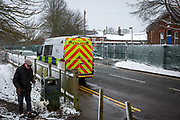 A Police van stationed outside Napier Barracks in the snow, on the 7th of February 2021, Folkestone, United Kingdom. The police have been forcing anyone who leaves back inside Napier Barracks due to COVID-19 restrictions, sometimes even carrying them back through the gates. Over 400 asylum seekers are being kept at Napier Barracks in unsuitable, cold accommodation, they are experiencing mental health issues as well as being vulnerable to health conditions including COVID-19. 3 people living inside the barracks have attempted suicide in 2021 already.