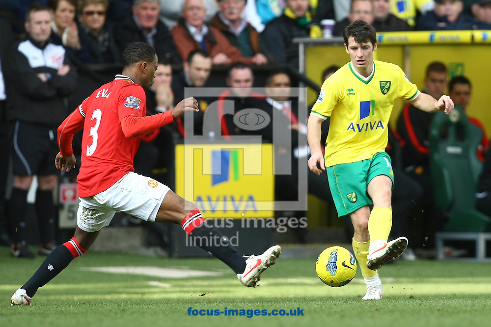 Picture by Paul Chesterton/Focus Images Ltd.  07904 640267.26/02/12.Wes Hoolahan of Norwich and Patrice Evra of Man Utd in action during the Barclays Premier League match at Carrow Road Stadium, Norwich.