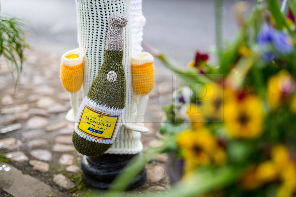 © Licensed to London News Pictures. 13/05/2018. Thirsk UK. Picture shows woollen Champagne & glasses. The Thirsk Yarn bombers have decorated the town centre of Thirsk in North Yorkshire this morning with Prince Harry & Megan Markle wedding related woollen creations to celebrate the upcoming royal wedding at the weekend. Photo credit: Andrew McCaren/LNP