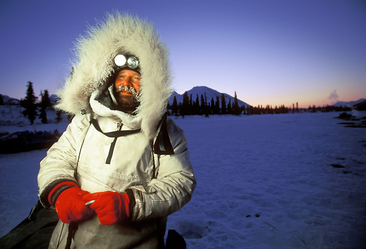 Retired pathologist Jim Lanier of Chugiak, Alaska, a veteran of 13 Iditarods who first ran the race in 1979,  prepares an early morning departure from Rainy Pass checkpoint during the Iditarod Sled Dog Race.