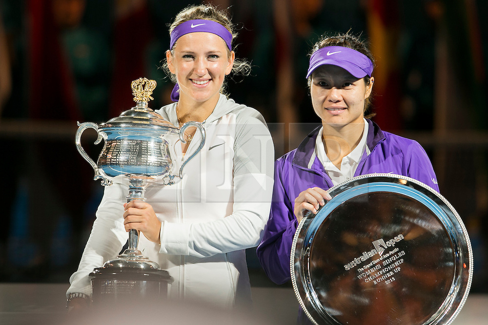 © Licensed to London News Pictures. 26/01/2013. Melbourne Park, Australia. Victoria Azarenka and Li Na pose with their trophies during the Womens Final between Victoria Azarenka and Li Na of the Australian Open. Photo credit : Asanka Brendon Ratnayake/LNP