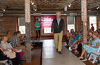 Mark Primeau wearing a casual weekend ensemble from Eddie Bauer works the runway during the Fashion Show at Belknap Mill on Sunday afternoon.  (Karen Bobotas/for the Laconia Daily Sun)