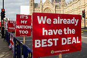 Anti Brexit signs by the pro EU demonstrators who have been outside parliament on a daily basis since September 2017 after the country voted to leave the European Union. House of Commons, Westminster, London, United Kingdom