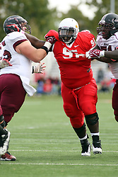 06 October 2012:  Albert Sparks takes on the double team of Tanner Crum and Richard Wilson during an NCAA football game between the Southern Illinois Salukis and the Illinois State Redbirds at Hancock Stadium in Normal IL