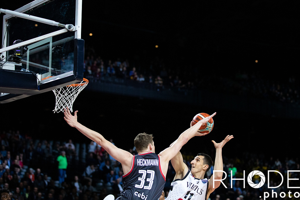 Patrick Heckmann (GER/Brose Bamberg) trying to block Dejan Kravic' shot (Dejan Kravic (CAN/Segafredo Virtus Bologna)<br /> <br /> Basketball Champions League Final Four Antwerp 2019<br /> Semi-Final: Virtus Segafredo Bologna (ITA) vs. Brose Bamberg (GER) : 67-50 <br /> <br /> ©RhodePhoto