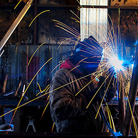 112213  Adron Gardner/Independent<br /> <br /> Weld sparks light up in front of Earl Peshlakai Gallup Portable Welding in Gallup Thursday.