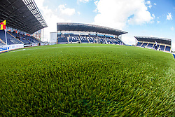 The three stands at The Falkirk Stadium, with the new pitch work for the Scottish Championship game v Morton. The woven GreenFields MX synthetic turf and the surface has been specifically designed for football with 50mm tufts compared with the longer 65mm which has been used for mixed football and rugby uses.  It is fully FFA two star compliant and conforms to rules laid out by the SPL and SFL.<br /> ©Michael Schofield.