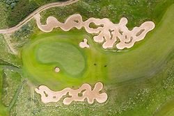 North Berwick, Scotland, UK. 9 July, 2020. Aerial view of golfers playing approach shots to green between elaborate bunkers on Fidra golf course part of the Archerfield Links development near North Berwick in East Lothian. Iain Masterton/Alamy Live News