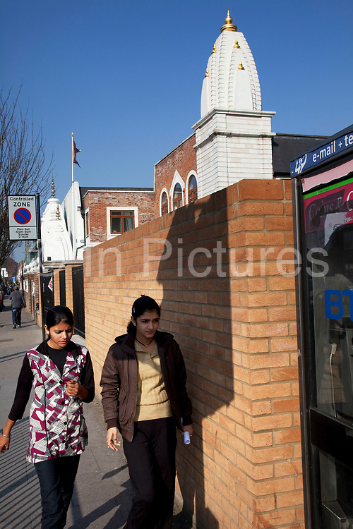 Vishwa Hindu Mandir / Temple on Lady Margaret Road. Southall in West London, also known as 'Little India' by some, is an area almost completely populated by people from South Asia. Figures show that the area is approximately 50 percent Indian in origin although walking the streets it would appear far higher as the local people go about their shopping in the many shops specialising in goods specific to this culture. The mix of religions is mainly Sikh, Hindu and Muslim.<br /> <br /> Southall is primarily a South Asian residential district. 1950 was when the first group of South Asians arrived in Southall, reputedly recruited to work in a local factory owned by a former British Indian Army officer. This South Asian population grew due to the closeness of expanding employment opportunities. The most significant cultural group to settle in Southall are Indian Punjabis.
