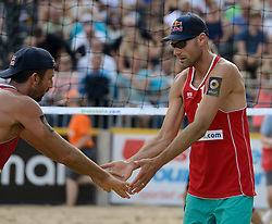 16-07-2014 NED: FIVB Grand Slam Beach Volleybal, Apeldoorn<br /> Poule fase groep A mannen - Sean Rosenthal (2), Philip Dalhausser (1) USA