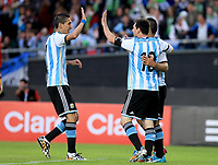 Fotball<br /> Argentina v Slovenia<br /> Foto: imago/Digitalsport<br /> NORWAY ONLY<br /> <br /> LA PLATA, June 8, 2014 (Xinhua) -- Argentina s Lionel Messi (C) celebrates after scoring with his teammates Sergio Aguero (R) and Angel Di Maria during the friendly match against Slovenia prior to the FIFA World Cup at Ciudad de La Plata Stadium, in La Plata, Argentina, on June 7, 2014.