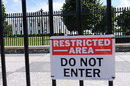 WASHINGTON - JUNE 29, 2019: The White House is seen through a fence from Pennsylvania Avenue NW on June 29, 2019, in Washington, D.C.