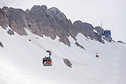 The lift on Marmolada ascends to Punta Rocca station above glacier, in Italy. From Malga Ciapela village, take a spectacular lift on Marmolada (Queen of the Dolomites) above the biggest (and only skiable) glacier in the Dolomiti: Ghiacciaio della Marmolada. Known as Marmoleda in Ladin, the highest peak in the Dolomites rises to 3343 meters (10,968 feet) elevation. Top station Punta Rocca gives a very exciting view of the surrounding mountains. The World War I museum at Serauta lift station describes the amazing City of Ice (Die Eisstadt, 1917), where Austrian soldiers inside the Marmolada Glacier built quarters in tunnels extending 12 kilometers with a vertical drop of over 1000 meters! Nine thousand Austrian and Italian soldiers died on the front line in a futile stalemate on and around Marmolada over 2 years. Find lift info at Funiviemarmolada.com. The Dolomites are part of the Southern Limestone Alps, in northern Italy, Europe. UNESCO honored the Dolomites as a natural World Heritage Site in 2009.