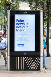 July 26, 2018 - Manchester, Greater Manchester, UK - Manchester , UK . An advert for social media platform Facebook in Piccadilly Gardens in Manchester City Centre , which reads '' Fake news is not our friend' (Credit Image: © Joel Goodman/London News Pictures via ZUMA Wire)