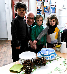 Pictured: Mr Swinney gets help to cut a cake of welcome from Yasin Said (five) Iver Blakey (four) and Clemence Currie (aged four)<br /> Deputy First Minister John Swinney visited Cowgate Nursery in Edinburgh to meet children, staff and modern apprentices working in early years and childcare. Mr Swinney confirmed that a record number of early years apprenticeships are expected to start this year as part of the expansion of free nursery and childcare.  Mr Swinney toured the nursery and discussed the City of Edinburgh Council's plans to expand the early years and childcare workforce and met with modern apprentices as well as Jake Stefanovic, an ambassador from the Scottish Government's childcare recruitment campaign.<br /> <br /> <br /> Ger Harley | EEm 13 February 2018