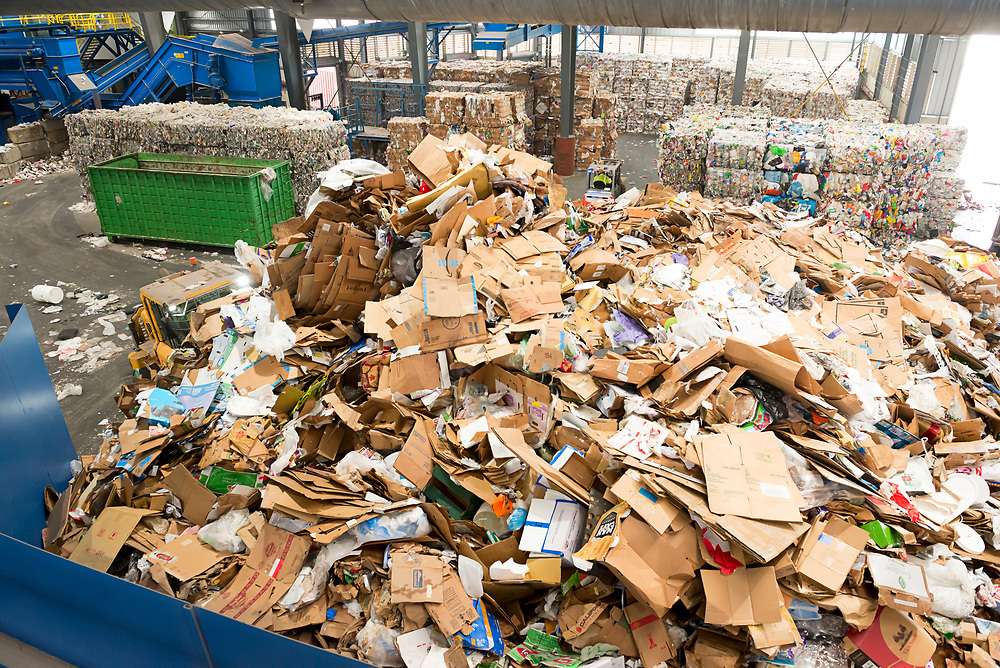 A front end loader consolidates the pile of recyclables delivered from local businesses to the MRF.