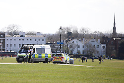 © Licensed to London News Pictures. 04/04/2020. London, UK. Police vehicles on patrol on Blackheath in South London at the start of a warm weekend in London. The government has reiterated that it is important for people to continue to follow social distancing rules to tackle the spread of Coronavirus. Photo credit: Rob Pinney/LNP