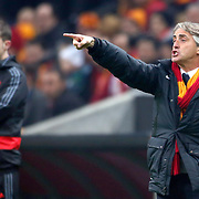 Galatasaray's coach Roberto Mancini (R) during their UEFA Champions League Round of 16 First leg soccer match Galatasaray between Chelsea at the AliSamiYen Spor Kompleksi in Istanbul, Turkey on Wednesday 26 February 2014. Photo by Aykut AKICI/TURKPIX