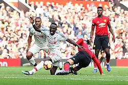 Manchester United's Chris Smalling (second right) tackles Liverpool's Sadio Mane during the Premier League match at Old Trafford, Manchester.