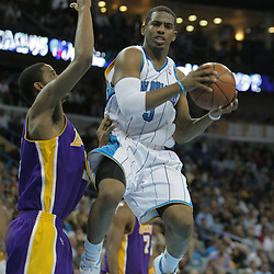 23 December 2008:  New Orleans Hornets guard Chris Paul (3) looks to pass as Los Angeles Lakers center Andrew Bynum (17) defends the play during a 100-87 loss by the New Orleans Hornets to the Los Angeles Lakers at the New Orleans Arena in New Orleans, LA. .