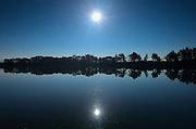 Reflection of sun in wetland<br /> Manville<br /> Alberta<br /> Canada