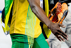 Nike Shoes of Usain Bolt of Jamaica  when winning the gold medal in the mens 4x100 Metres Relay Final with mascot Berlino during day eight of the 12th IAAF World Athletics Championships at the Olympic Stadium on August 22, 2009 in Berlin, Germany. (Photo by Vid Ponikvar / Sportida)