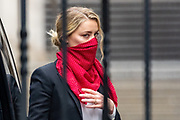 """Actress Amber Heard arrives at the High Court in London on Friday, July 24, 2020. She will attend a hearing in Johnny Depp's libel case against the publishers of The Sun and its executive editor, Dan Wootton. <br /> 57-year-old Depp is suing the tabloid's publisher News Group Newspapers (NGN) over an article which called him a """"wife-beater"""" and referred to """"overwhelming evidence"""" he attacked Ms Heard, 34, during their relationship, which he strenuously denies. (VXP Photo/ Vudi Xhymshiti)"""