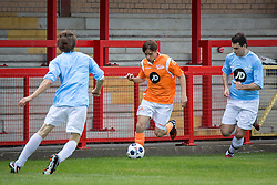 © Licensed to London News Pictures . 02/08/2015 . Droylsden Football Club , Manchester , UK . ELLIOTT TITTENSOR (l) comes in to challenge NICO MIRALLEGRO (on the ball) . Celebrity football match in aid of Once Upon a Smile and Debra , featuring teams of soap stars . Photo credit : Joel Goodman/LNP