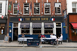 © Licensed to London News Pictures. 04/07/2020. London, UK. The French House reopens to customers as restaurants and bars reopen after a relaxing of rules during the Covid-19 pandemic. Photo credit: Ray Tang/LNP