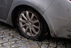 © Licensed to London News Pictures. 07/12/2018. London, UK. A car carrying England cricketer Ben Stokes suffers a flat tyre as it leaves an ECB disciplinary panel hearing in central London. The England and Wales Cricket Board will rule later today on whether further disciplinary action will be taken against Ben Stokes and fellow cricketer Alex Hales over their involvement in a fight outside a nightclub in Bristol in 2017. Both are charged with two counts of bringing the game into disrepute. Photo credit: Ben Cawthra/LNP