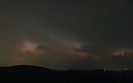 Ellenville, New York -  Lightning from distant thunderstorms lights up clouds above the mountains on the night of July 17, 2010.