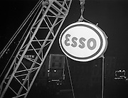 08/02/1963<br /> 02/08/1963<br /> 08 February 1963<br /> New Esso sign being erected at O'Connell Street Dublin. The sign being hoisted into place by crane.
