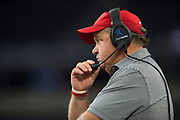 Iraan High School football head coach Mike Kirchhoff looks on during the state championship game at AT&T Stadium in Arlington, Texas on December 15, 2016. (Cooper Neill for The New York Times)