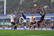 Arouna Kone of Everton heads and scores his teams 6th goal (his 3rd to complete his hat -trick). Barclays Premier League match, Everton v Sunderland at Goodison Park in Liverpool on Sunday 1st November 2015.<br /> pic by Chris Stading, Andrew Orchard sports photography.