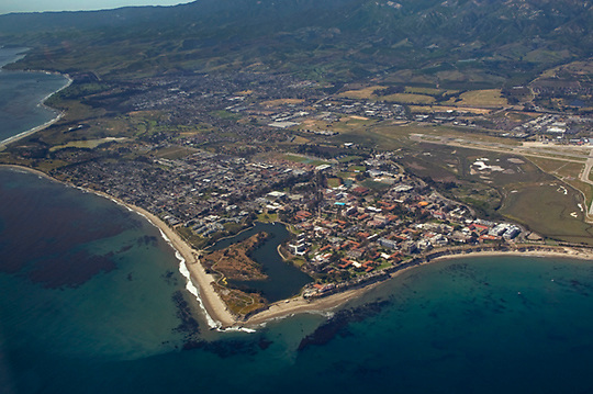 View of the University of California at Santa Barbara Campus Lagoon from the air looking northwest. The Lagoon is a large man-made body of water adjacent to the coastline, between San Rafael and San Miguel Residence Halls. It was created from a former tidal salt marsh flat and is fed by a combination of run-off and ocean water used by the Marine Science Building's aquatic life tanks; thus, it is a unique combination of fresh and salt water (wiki 2009).