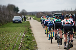 The peloton get strung out at the 2020 Omloop Van Het Hageland, a 130 km road race from Tienen to Tielt-Winge, Belgium on March 1, 2020. Photo by Sean Robinson/velofocus.com